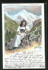Künstler-AK C. Steinmann: Berner Oberländer-Tracht, Dame vor Alpenpanorama