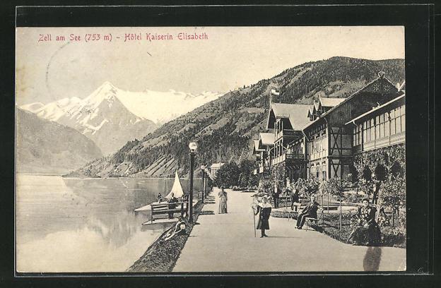 AK Zell am See, Hotel Kaiserin Elisabeth, Uferpromenade mit Blick auf Gebirge