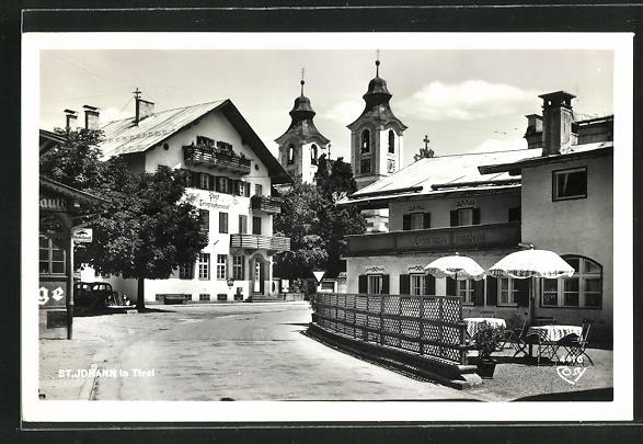 AK St. Johann, Strassenansicht mit Post- und Telegraphenamt, Kirchtürme, Gasthaus zum Seisl