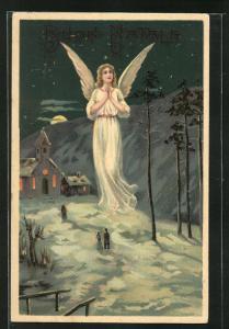 AK betender Weihnachtsengel und Gläube auf dem Weg zur eingeschneiten Kirche
