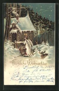 AK Weihnachtsengel mit Geschenken vor einem Haus am Waldrand