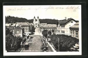 AK Amstetten, Bahnhofstrasse mit Herz Jesu Kirche