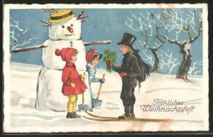 AK Kinder bauen einen Schneemann und Schornsteinfeger überbringt Glücksklee, Fröhliches Weihnachtsfest