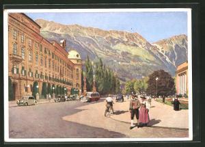 Künstler-AK Innsbruck, -Platz mit Nordkette und Mann und Frau in Trachten