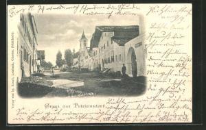 AK Putzleinsdorf, Strassenpartie mit Kirchturm