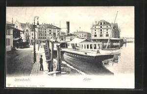 AK Rorschach, Hafen mit Dampfschiff, Häuser und Passant