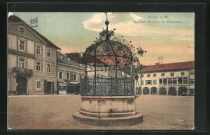 AK Bruck a. Mur, Altertümlicher Brunnen am Hauptplatz