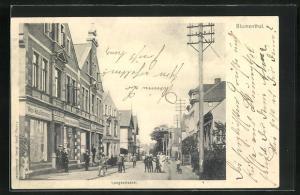 AK Blumenthal, Langestrasse mit Geschäften