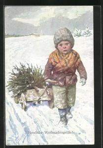 Künstler-AK Karl Feiertag: Herzliche Weihnachtsgrüsse, Junge zieht den Karren mit dem Tannenbaum durch den Schnee
