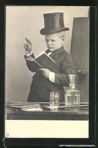 AK Junge mit Zylinder u. Buch am Pult vor der Tafel