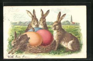 Präge-AK Osterhasen neben einem Nest mit Eier