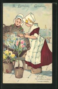 AK Mädchen in holländischer Tracht am Blumenstand, Geburtstagsgruss