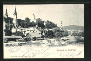 AK Brunneck, Ortsansicht mit Blick auf Fluss mit Brücke, Häuser und Kirchen