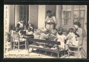 AK Estavayer, Le Foyer gardien, Kinder sitzen am Tisch
