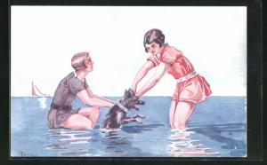 AK Zwei junge Damen in Badeanzügen spielen im Wasser mit einem Hund