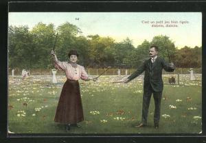AK Mann und Frau spielen mit dem Diabolo auf einer Wiese