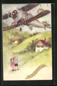 Künstler-AK Hannes Petersen: Kinder mit Kleeblatt zeigen auf Propellerflugzeug mit Rosengirlanden