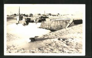 AK Nome, Alaska, Coast Gauro Boat frozen in for the Winter
