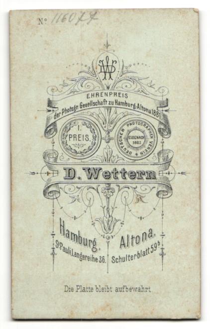 Fotografie D. Wettern, Hamburg, Mann im Anzug mit Oberlippenbart und strengem Mittelscheitel 1
