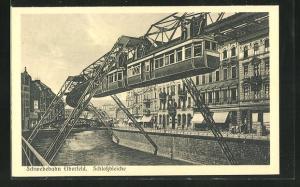 AK Elberfeld, Schwebebahn, Schlossbleiche über Fluss mit Blick auf Brücke und Häuserfassaden