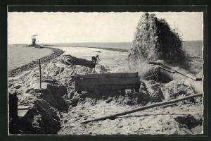 AK Zuidelijk, Dijkbouw Z. Flevoland, Opspuiten can het zandlichaarn tussen de keileemdammen
