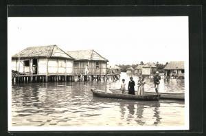 AK Maracaibo, Stelzenhäuser und Dorfbewohner im Kanu