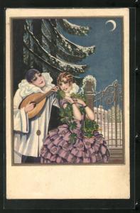 AK Art Deco, Harlekin spielt auf Mandoline für junge Frau mit Kleeblattkette vor schneebedeckter Tanne
