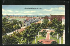 AK Kingston, Commercial, Blick auf Platz mit Palmen, Häusern und Meer