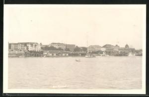 AK Rangoon, Ortsansicht vom Meer auf Häuser und Schiffe