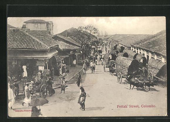 AK Colombo, Pettah Street mit Händlern und Häusern 0