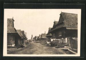 AK Hrustin, Une Rue, Strassenpartie im Ort
