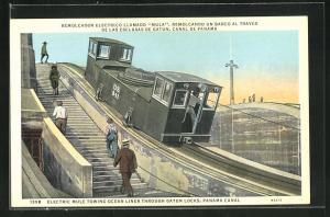AK Panama Canal, Electric Mule towing Ocean Liner through Gatun Locks