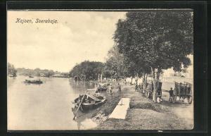 AK Soerabaja, Kajoen, Kanu am Flussufer
