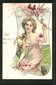Künstler-AK blondes Mädchen mit langem Haar und Blumenzweig auf einem Baum sitzend, Jugendstil