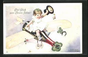 Künstler-AK E. Reckziegel: Kind fliegt auf der Sektflasche ins neue Jahr