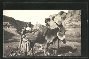AK Melilla, arabische Mädchen mit ihrem Esel