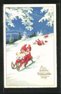 AK Zwerge fahren mit Geschenken und Briefen den verschneiten Hang hinab, Fröhliches Weihnachtsfest