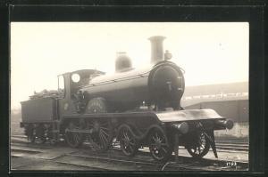 AK englische Eisenbahn Bessemer mit Bauschutt im Waggon