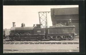 AK englische Eisenbahn mit Kennung 2324 und Bauschutt im Waggon
