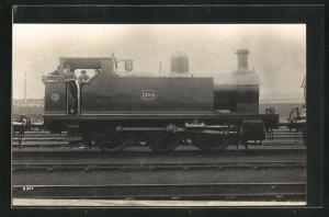 AK englische Eisenbahn, 1354, Lokomotive mit Zugführer