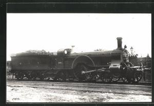 AK englische Eisenbahn, 94, G N R, Lokomotive mit Zugführer und Kohlentender