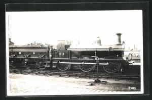 AK englische Eisenbahn der Gesellschaft MR mit Kennung 1611 und Bauschutt im Waggon