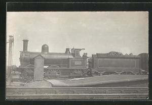 AK englische Eisenbahn mit Kennung 2446 und Bauschutt im Waggon