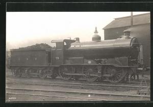 AK englische Eisenbahn der Gesellschaft GNR mit Kennung 73 und Bauschutt im Waggon