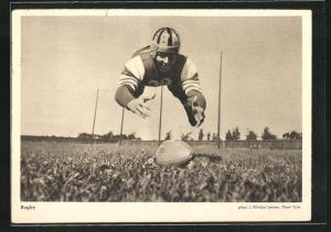 AK Rugby-Spieler wirft sich auf den Ball