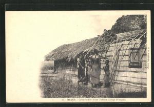 AK Mpaka, Construction d`une Toiture, Männer beim Dach decken