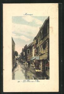 AK Montargis, La Rue sur l`Eau et Maisons
