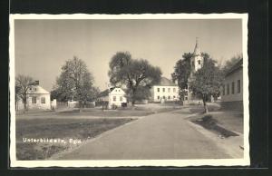 AK Unterbildein, Strassenpartie mit Blick zur Kirche