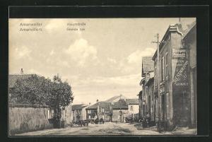 AK Amanweiler, Hauptstrasse mit Werbung für Gartenwirtschaft Restauration E. Pompey