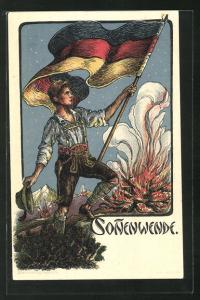 AK Sonnenwende, Junger Mann in Tracht mit deutscher Flagge